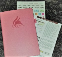 pink journal with two paper inserts